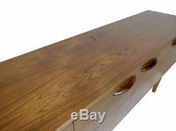 Teak Mid Century Modern credenza or media console with stunning grain by Avalon